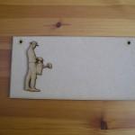 (P17) Man Watering Plaque